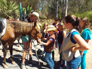 girl scouts had fun with horses and earned their fun